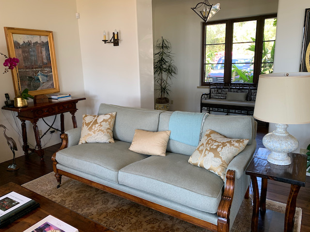 Pale Blue Wood Frame Sofa on Casters