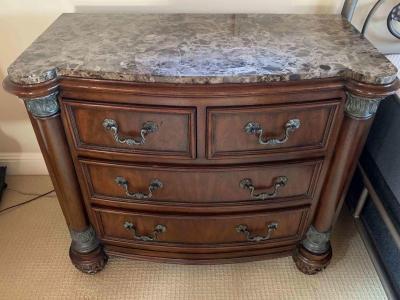 Pair of marble top nightstands by Drexel