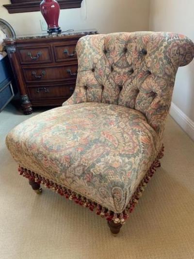 Upholstered slipper chair with fringe